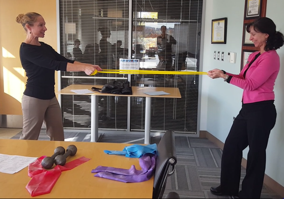 Cornell Wellness and PT specialists demonstrate at work exercise